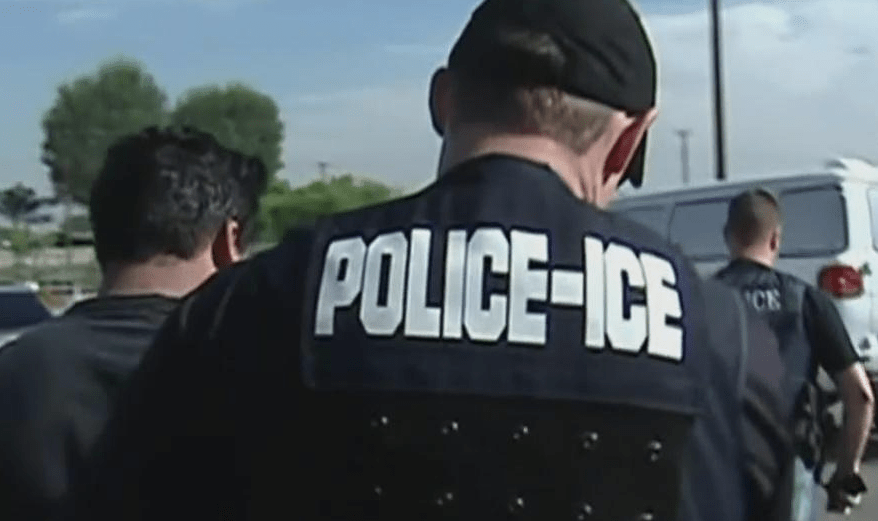 ice police arresting someone