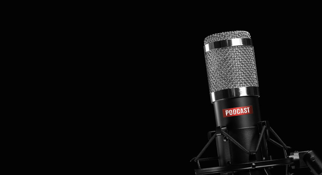 grey and black microphone on a black background