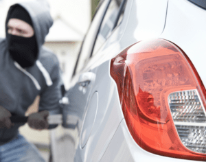 A man attempting to steal a car