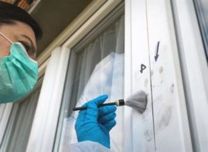 home burglary investigated by a forensic specialist