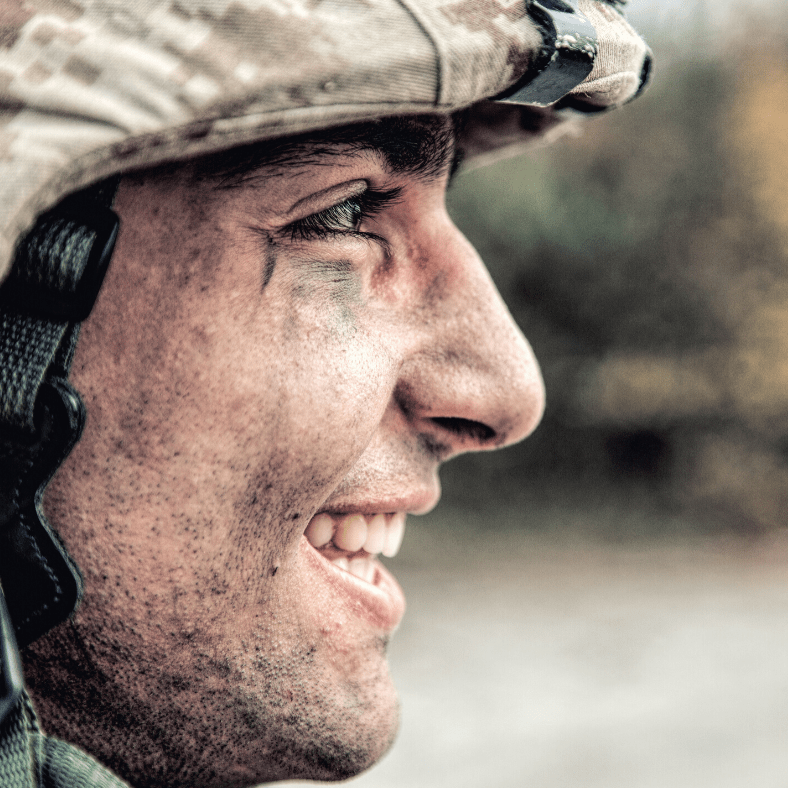 A soldier smiling
