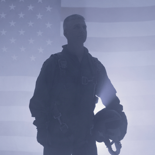 Airman with an american flag in the background