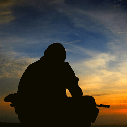 Soldier alone in silhouette during sunset