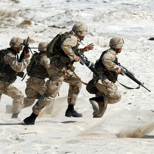 Soldiers running on a battlefield
