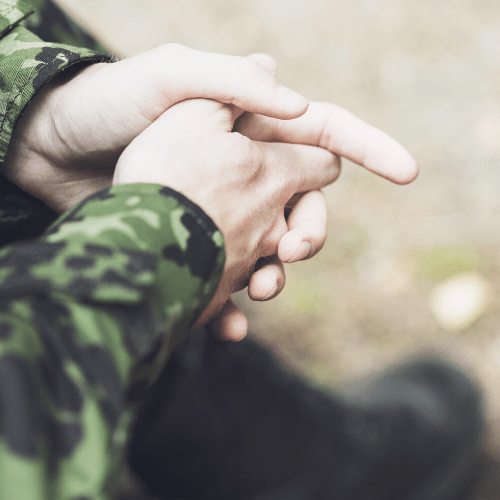 a military members hands folded