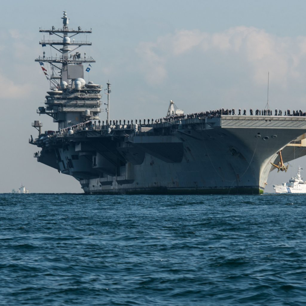 171204-N-CL027-112 TOKYO BAY (Dec. 4, 2017) Sailors man the rails as the Navy's forward-deployed aircraft carrier, USS Ronald Reagan (CVN 76), arrives at Commander, Fleet Activities Yokosuka after a scheduled patrol. The Ronald Reagan Carrier Strike Group conducted 87 days of strike group operations in the Western Pacific, including the waters south of Japan, the Philippine Sea and the South China Sea. Ronald Reagan provides a combat-ready force, which protects and defends the collective maritime interests of the U.S. and its allies and partners in the Indo-Asia-Pacific region. (U.S. Navy photo by Mass Communication Specialist 2nd Class Janweb B. Lagazo/Released)